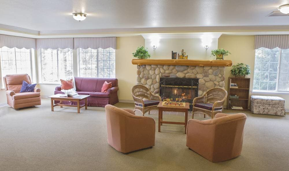 Gorgeous living room with a fireplace at Birchview Memory Care