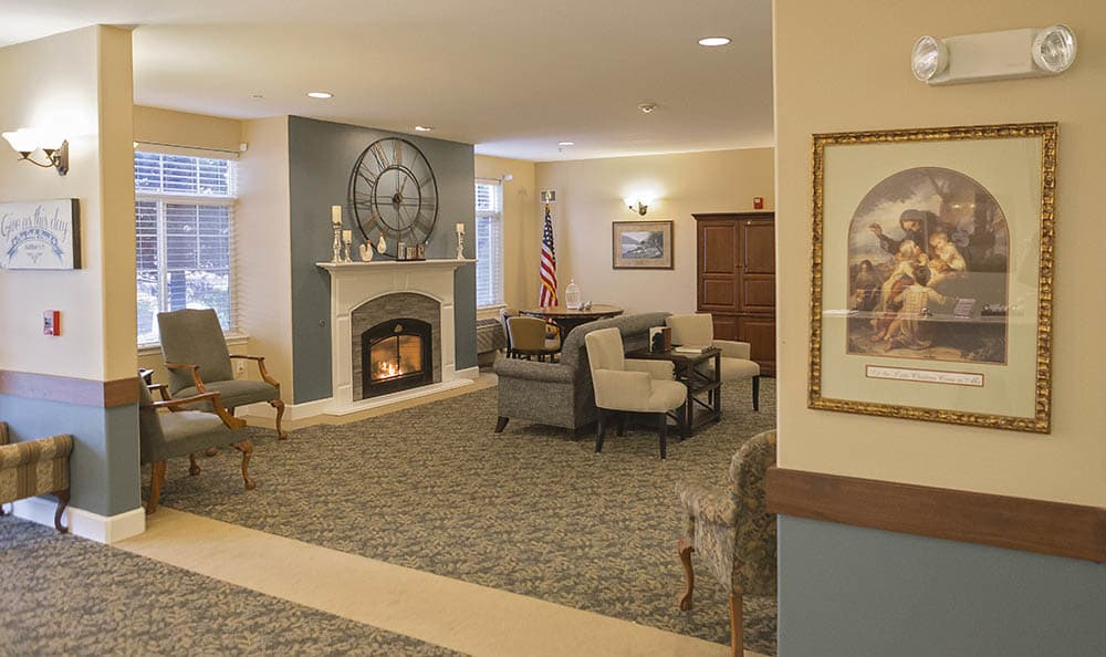 Gorgeous living room with a fireplace at King's Manor Senior Living Community