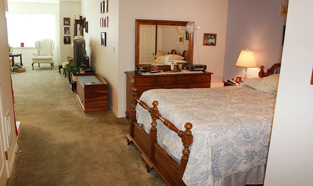 Well decored bedroom in King's Manor Senior Living CommunityWell decored bedroom in King's Manor Senior Living Community