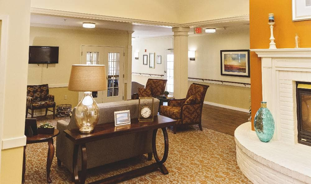 Gorgeous living room with a fireplace at Broadmore Senior Living at Hagerstown
