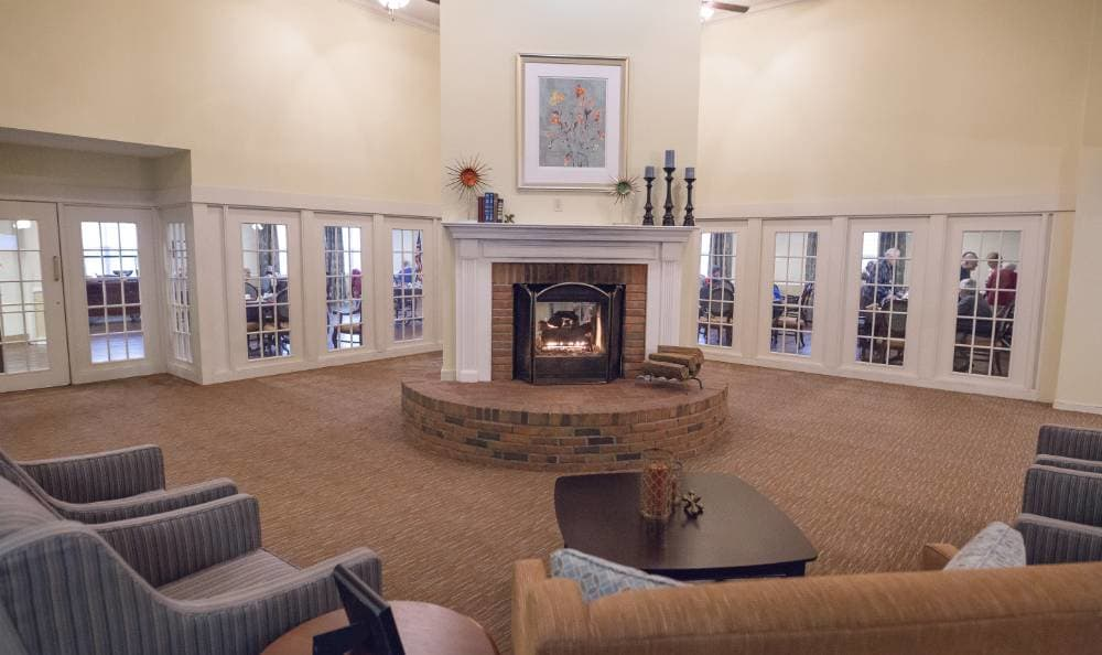 Gorgeous living room with a fireplace at Broadmore Senior Living at Teays Valley