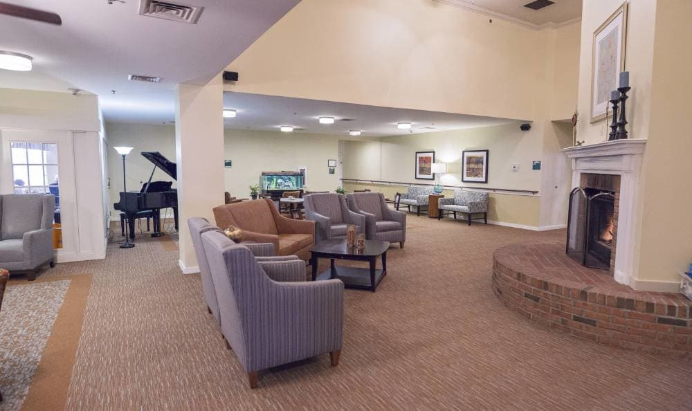 A fireplace mimics the warmth of the day in our living room at Broadmore Senior Living at Teays Valley