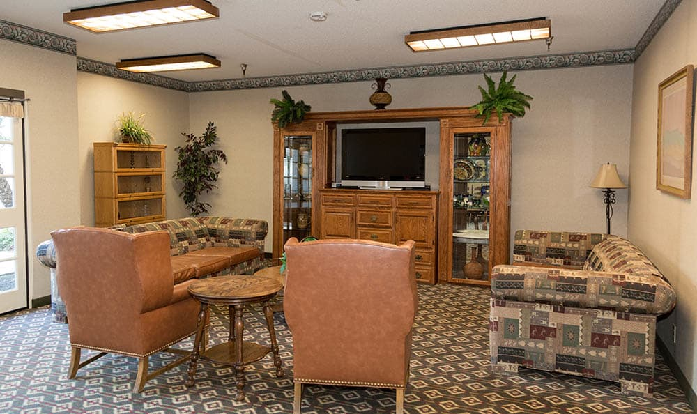 Tv Room With Plenty Of Couch Space At Del Obispo Terrace Senior Living