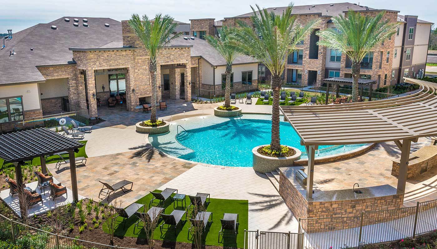Aerial view of the well-planned and beautifully decorated swimming pool area at The Abbey at Spring Town Center