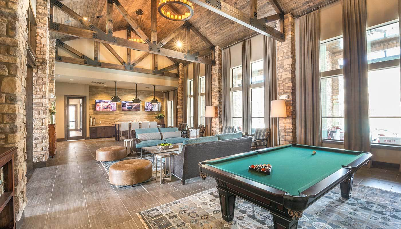 Fantastic interior view of clubhouse at The Abbey at Spring Town Center with vaulted ceilings and exposed timbers, showcasing billiards table