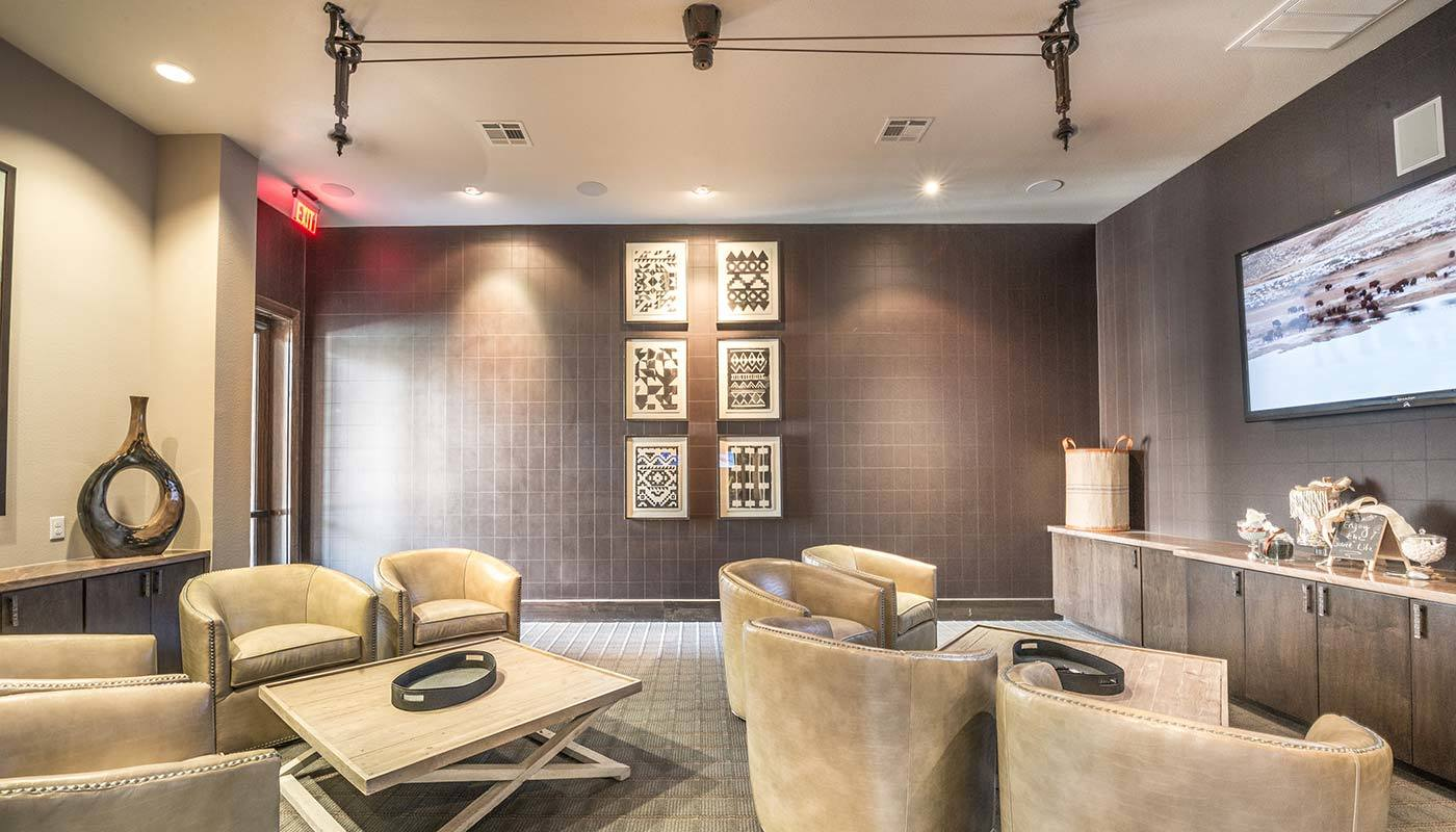 Beautifully decorated common area with comfortable seating at The Abbey at Spring Town Center