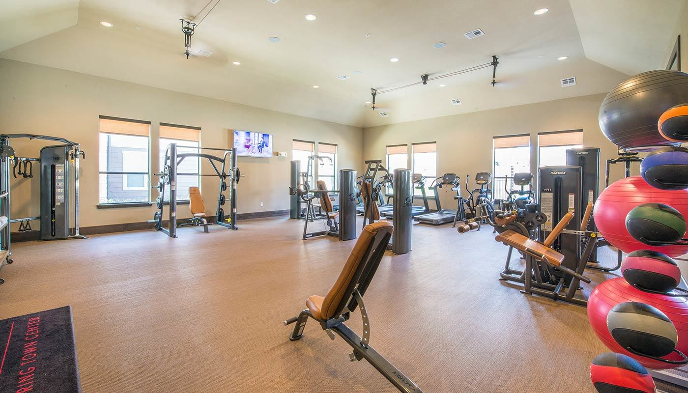 Fully equipped fitness center at The Abbey at Spring Town Center in Spring