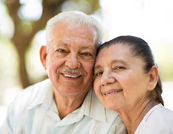 Elderly couple pose for a photo at Wyndham Court of Plano in Plano, Texas