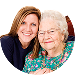 A caretaker with senior resident at Wyndham Court of Plano in Plano, Texas