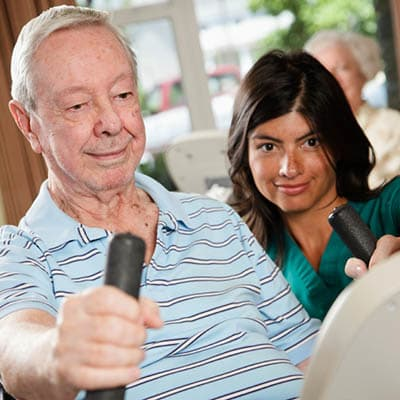 Man doing physical therapy at Cedar Bluff Assisted Living & Memory Care in Mansfield