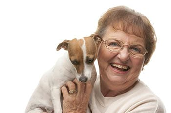 Woman with a dog at Cedar Bluff Assisted Living & Memory Care in Mansfield