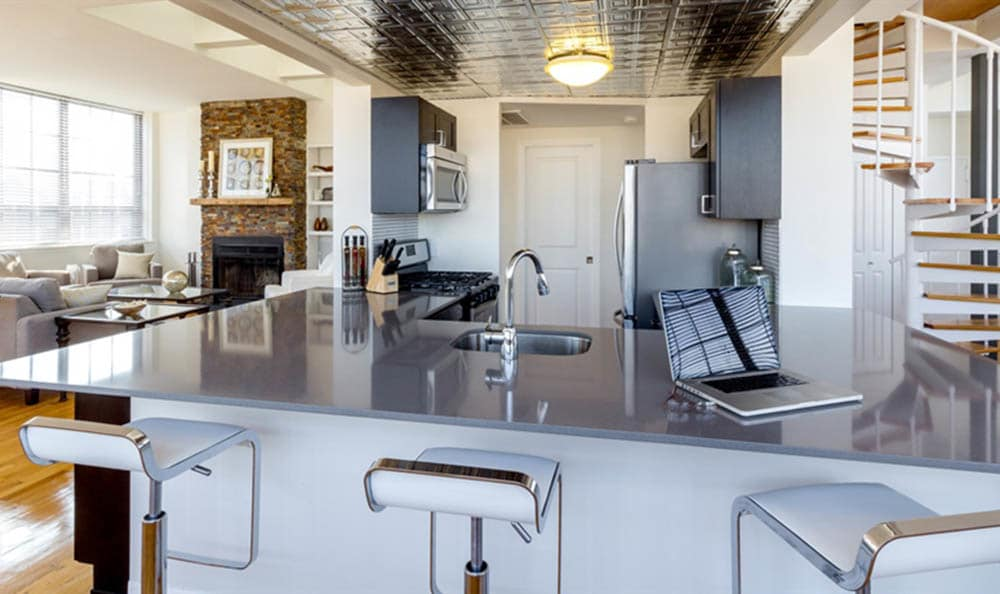 Stylish kitchen with bar stools at Grand Adams in Hoboken, NJ