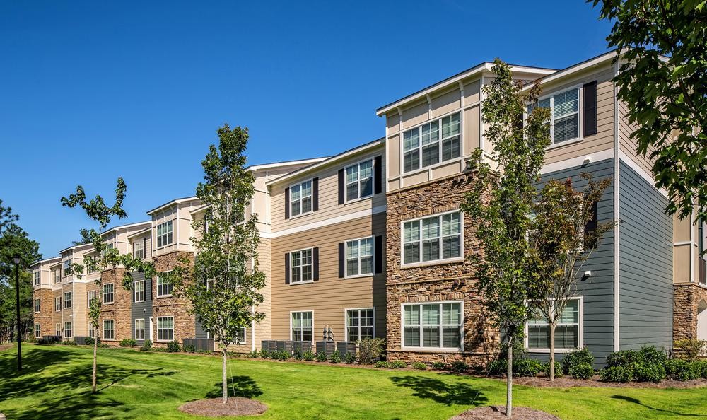 apartments exterior view from backyard at Avana Highland Ridge Apartments in Columbus, GA