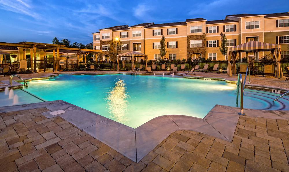 lit swimming pool at Avana Highland Ridge Apartments in Columbus, GA