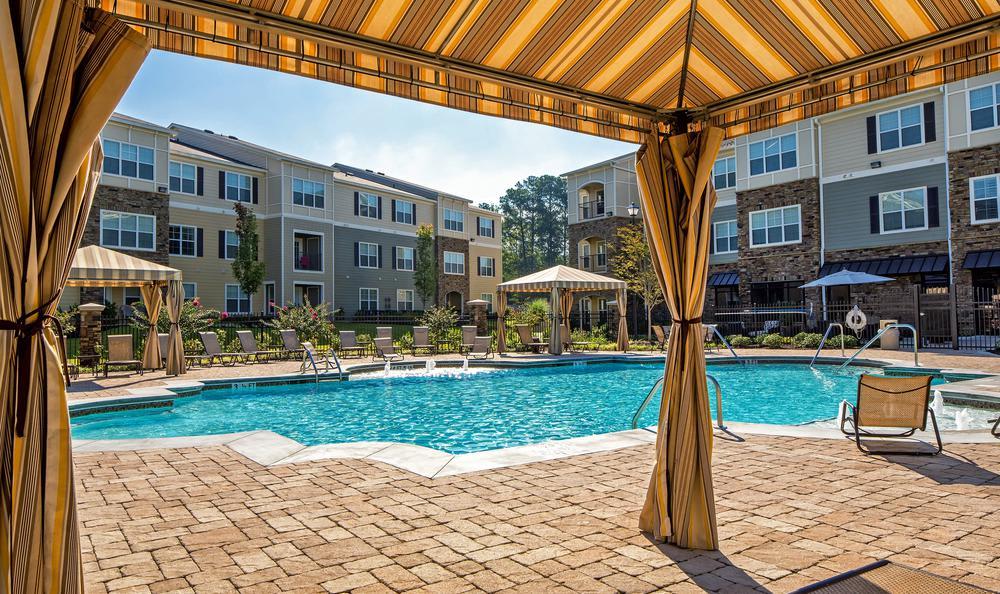 tent near swimming pool at Avana Highland Ridge Apartments in Columbus, GA