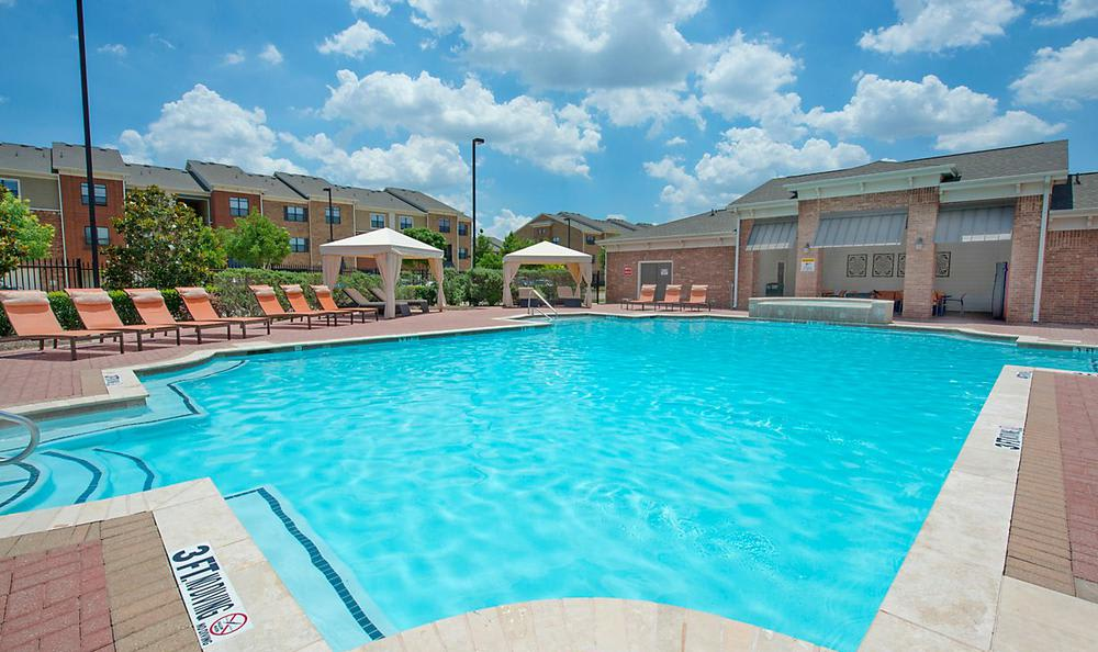 Swimming Pool With Chairs at Avana McKinney Ranch Apartments in McKinney, TX