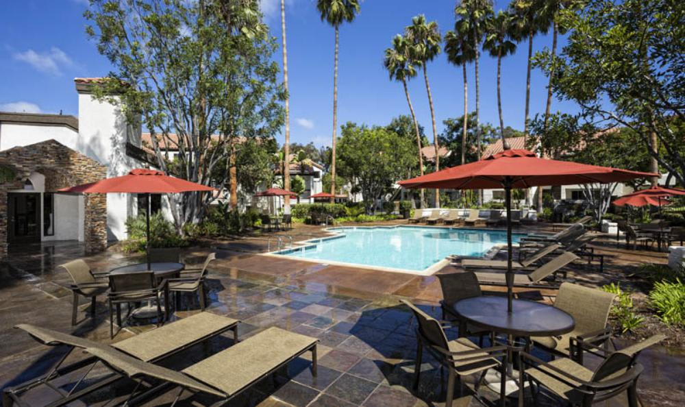 Small Pool Surrounded With Chairs at Avana San Clemente Apartments in San Clemente, CA