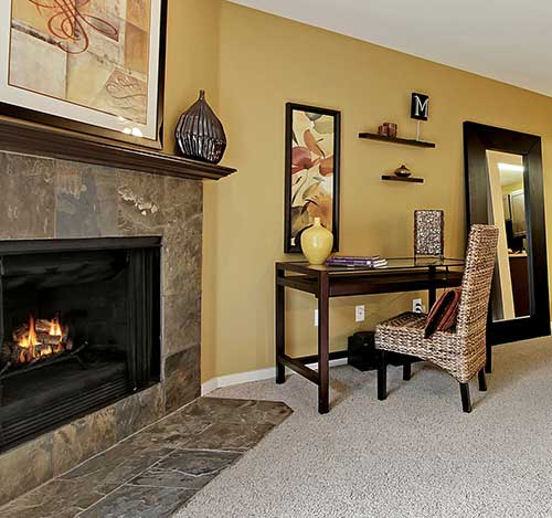 The fireplace is an excellent apartment amenity at The Mill at Mill Creek Apartments.