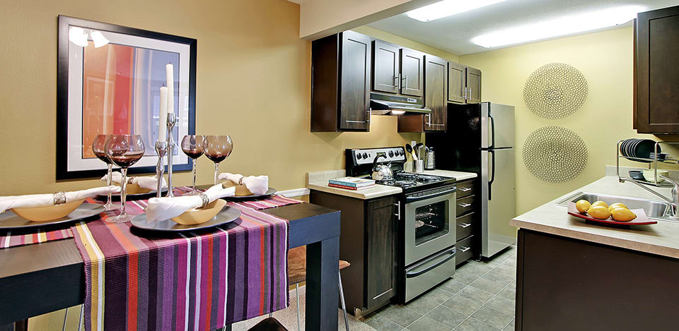 The kitchen is fully equipped at The Mill at Mill Creek Apartments