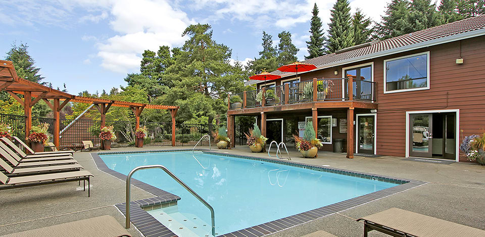 Take a dip in the luscious pool at The Mill at Mill Creek Apartments.