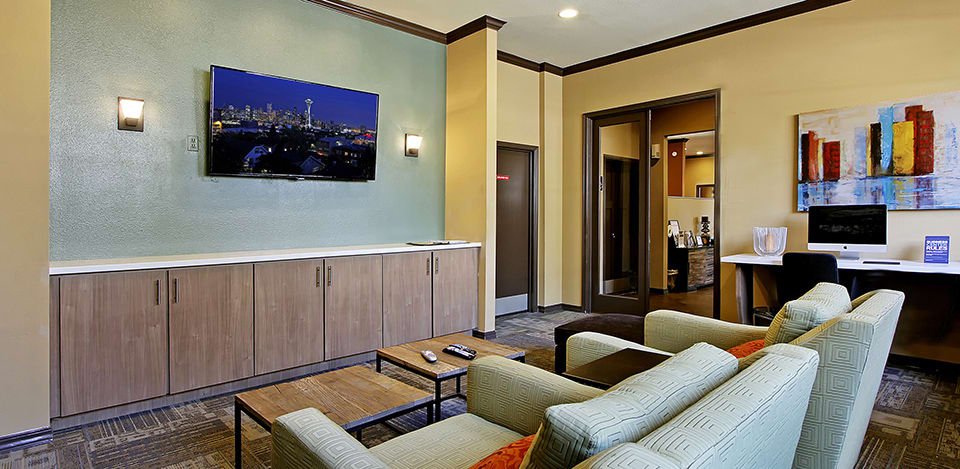 Lounge and relax by the community theatre at The Mill at Mill Creek Apartments