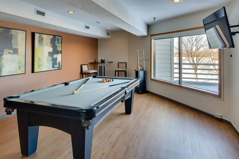 Pool table at Avana on Seven Apartments