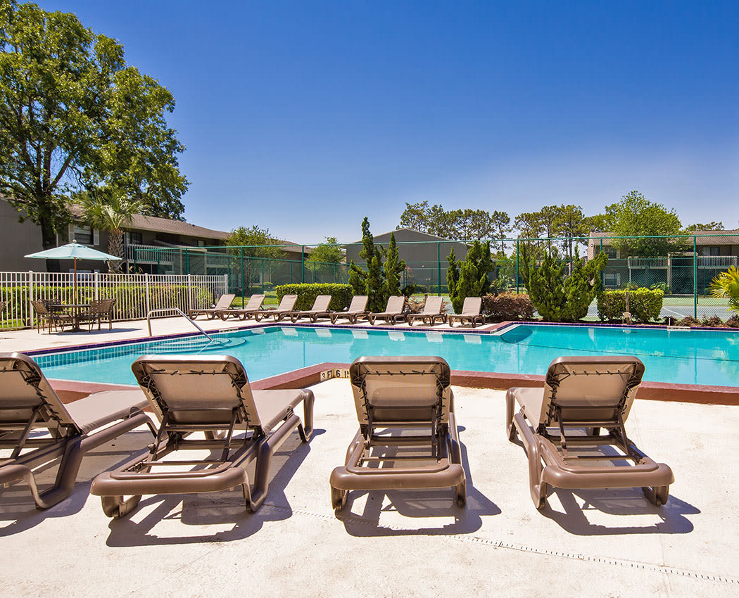 Sit near the pool at Arbors at Orange Park