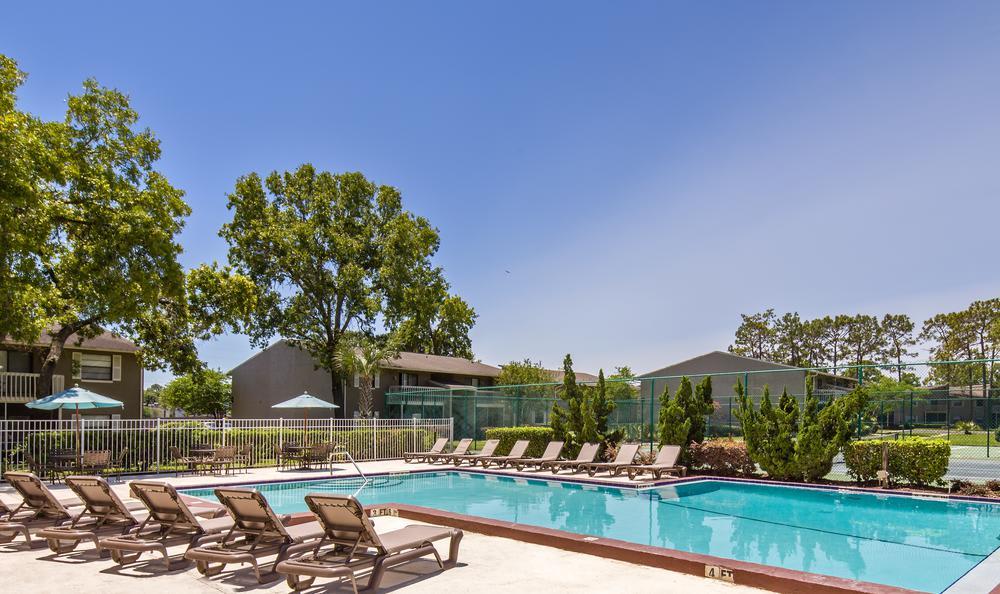 Swimming Pool With Chairs at Arbors at Orange Park in Orange Park, FL