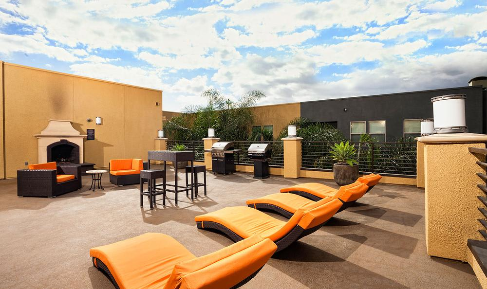 Outdoors Grilling Area With Furniture at Avana North Hollywood Apartments in North Hollywood, CA