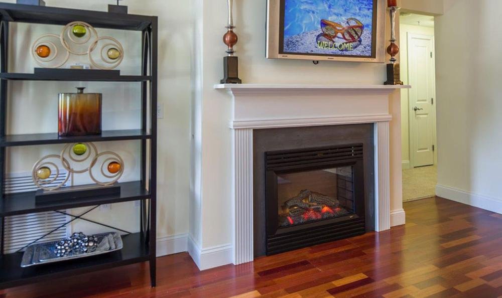 Living Room With Chimney at Avana Abington Apartments in Abington, MA