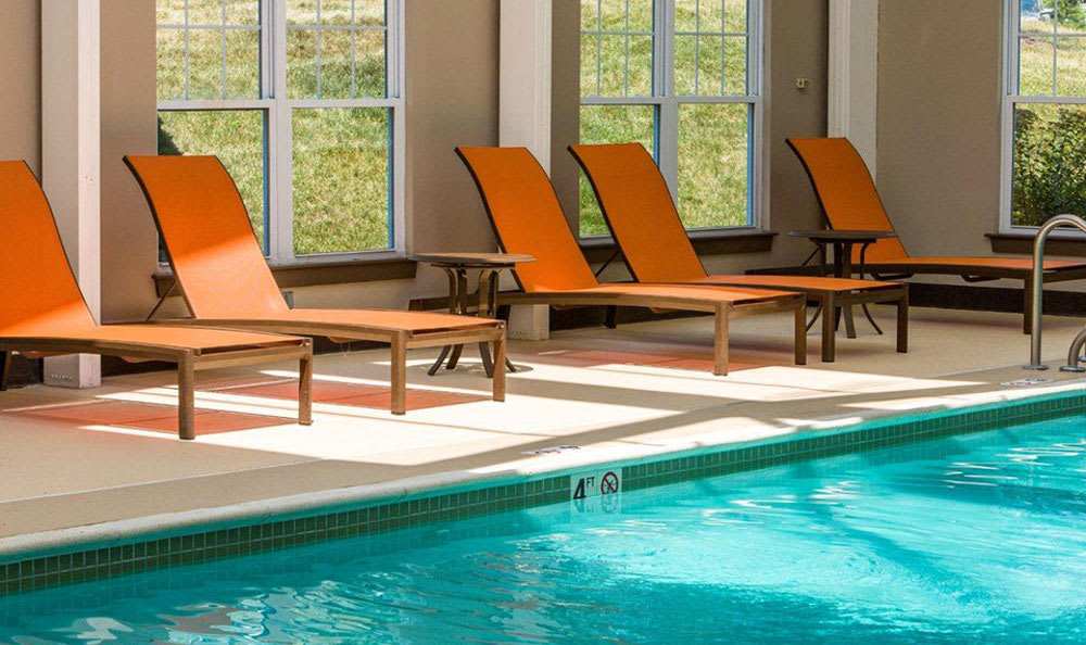 Pools Chairs at Avana Abington Apartments in Abington, MA