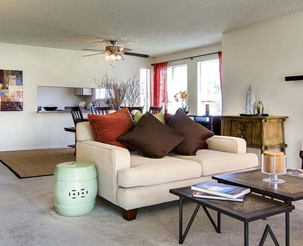 well decorated living room at Deerfield Apartments in Denver, CO