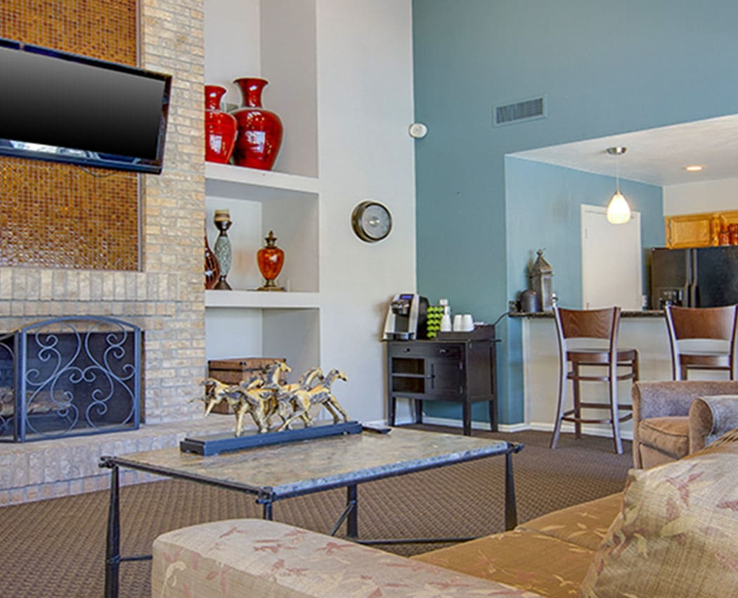 Living room at Deerfield Apartments in Denver, CO