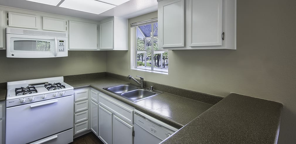 fully equipped kitchen room at Sunset View Apartments in Oceanside, CA