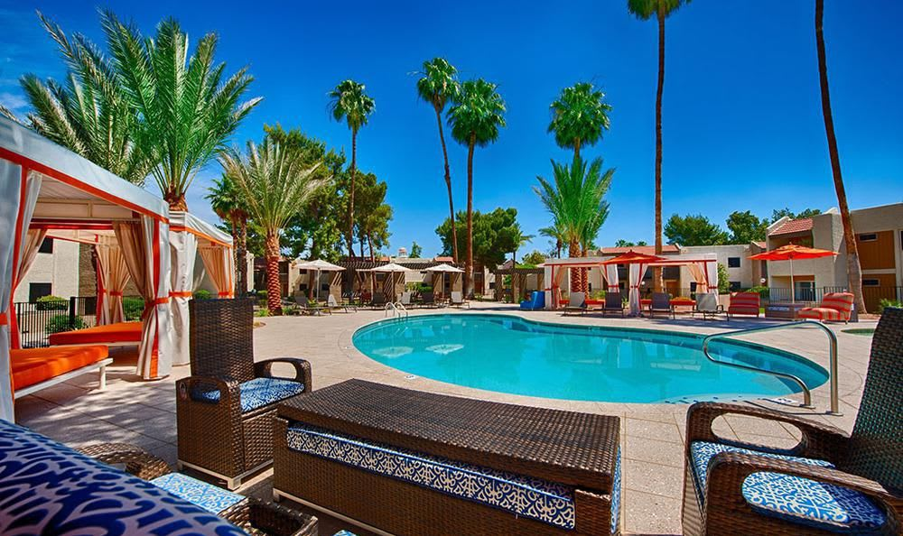 Pool Surrounded By Comfy Tends at Avana McCormick Ranch Apartments in Scottsdale, AZ