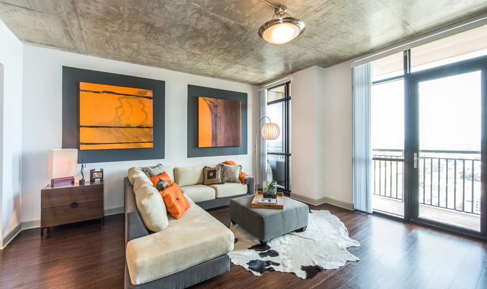 Expansive living area in 55 West Apartments model home showcasing the hardwood floors and beautiful decor