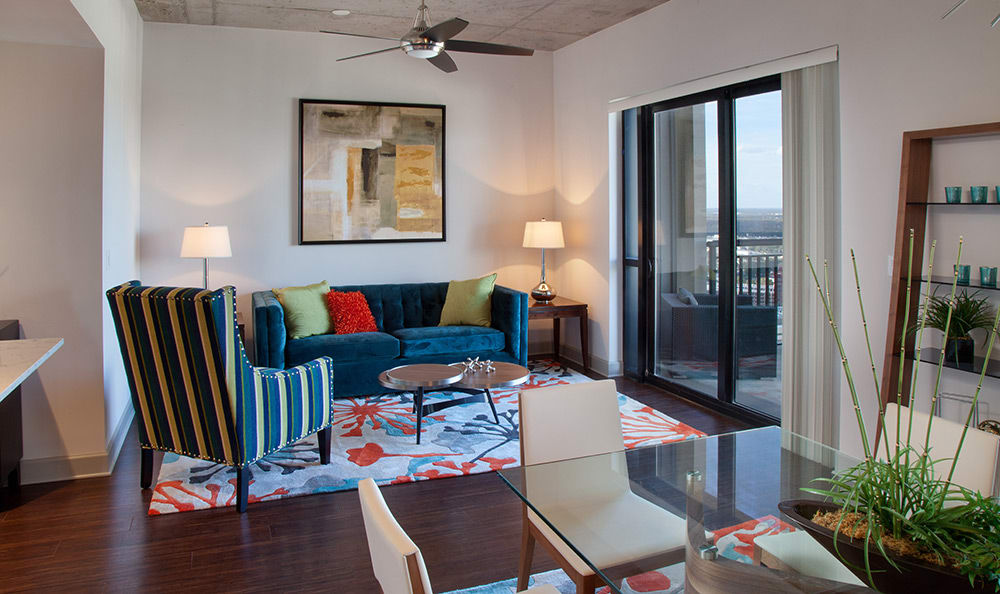 Model home's living and dining area in 55 West Apartments home, with the Orlando skyline in the background