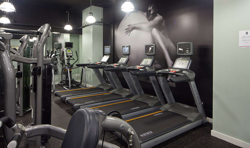Rows of treadmills waiting for you at the fitness center at 55 West Apartments