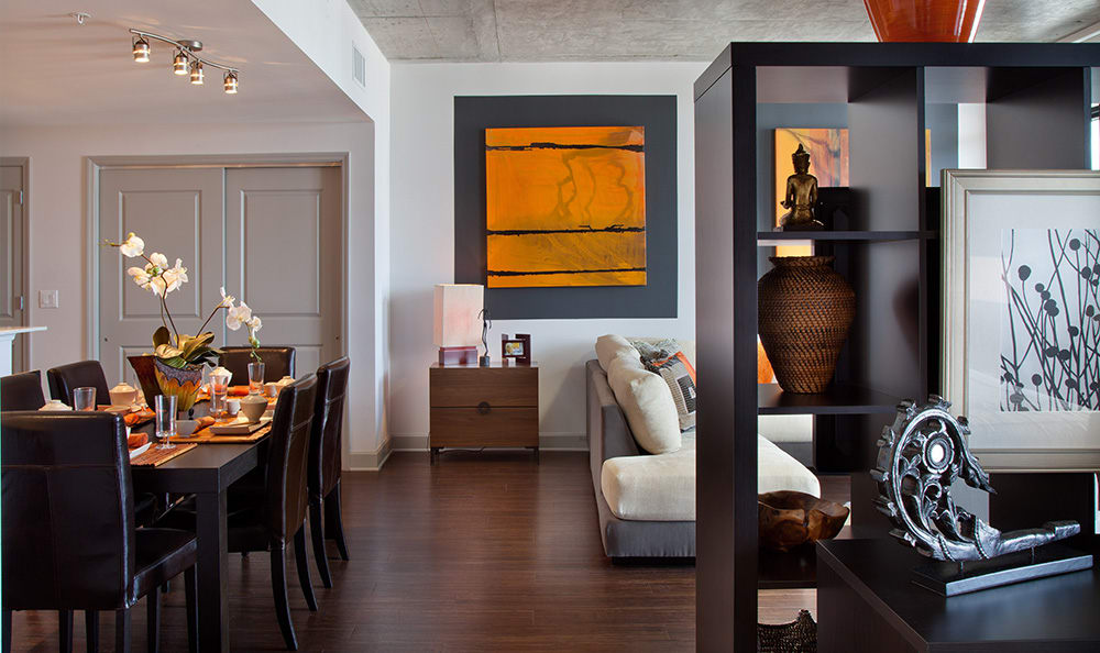 Gorgeously appointed model apartment home's living and dining area at 55 West Apartments