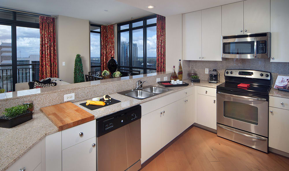 Modern kitchen in 55 West Apartments model home has all the conveniences and finishes you desire