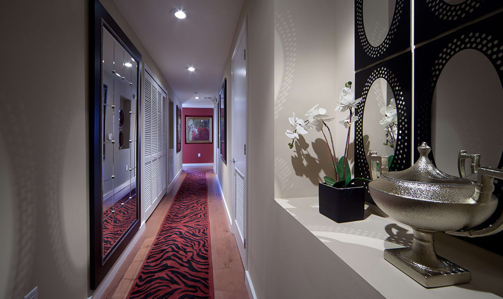 Long hallway beautifully decorated in model home at 55 West Apartments