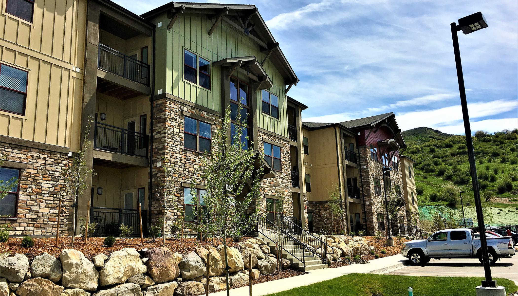 Apartments with parking lot at The Reserves at Steamboat Springs in Steamboat Springs, CO