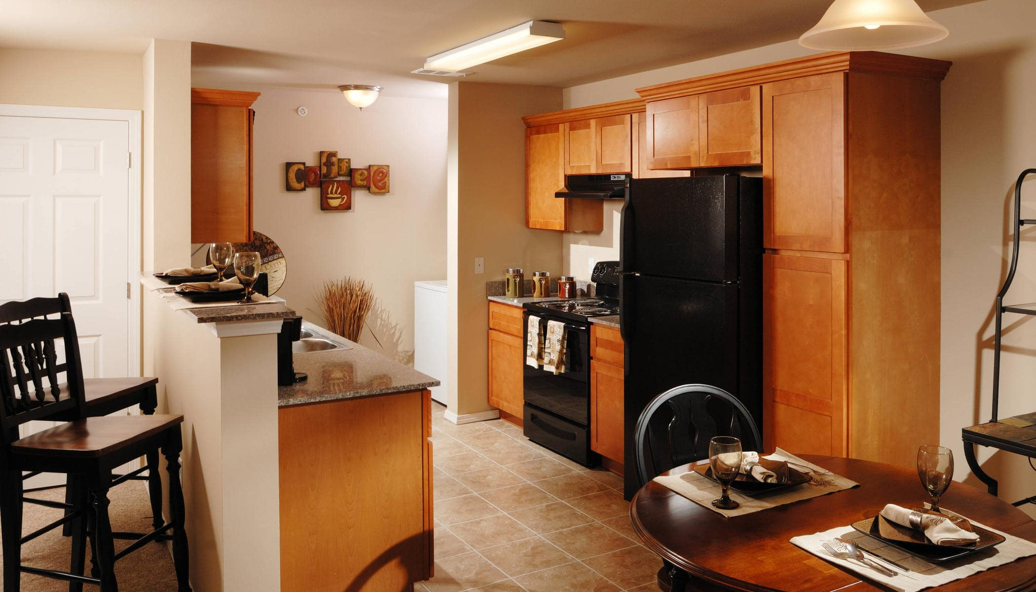 High end kitchen with breakfast bar at Bee Creek Apartments