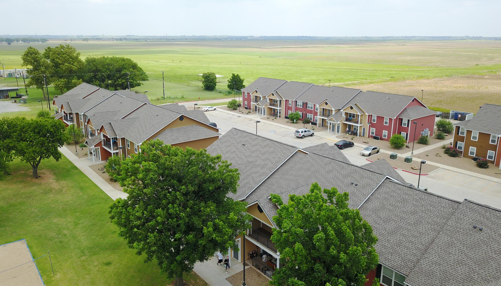 Apartments with parking lot at The Reserves at Saddlebrook