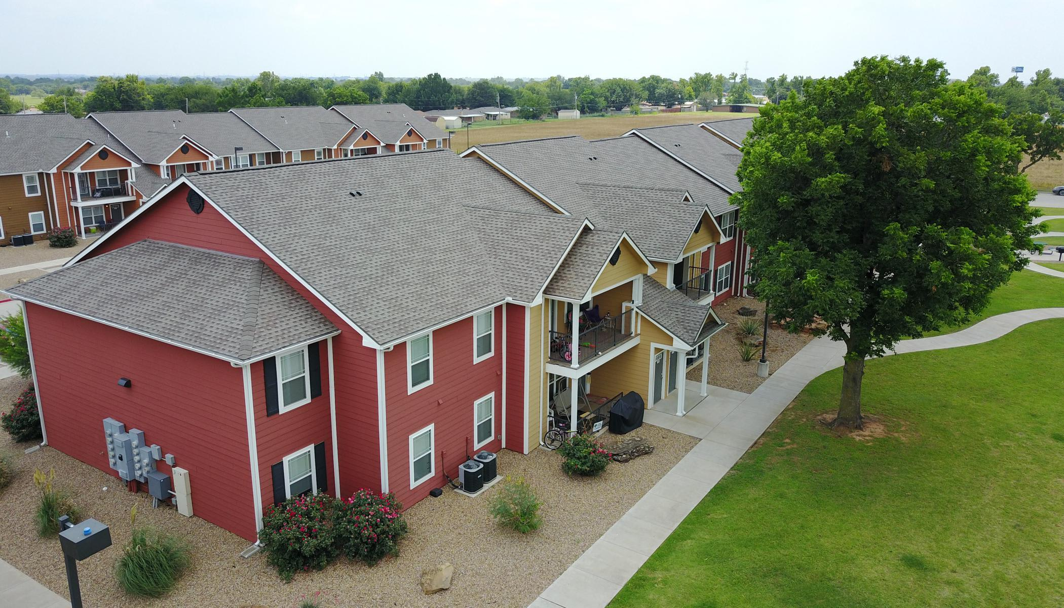 Apartments surrounded with courtyards at The Reserves at Saddlebrook in Burkburnett, TX