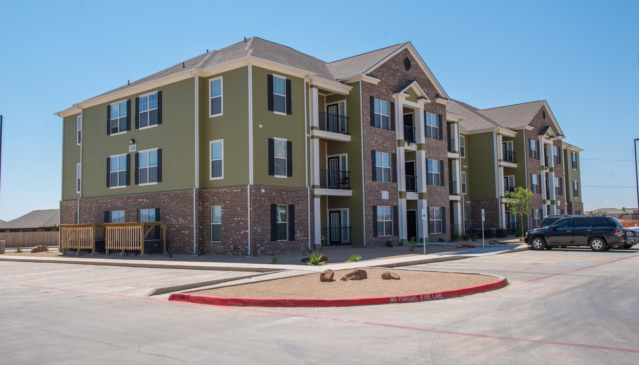 Apartments with spacious parking area at The Reserves at South Plains in Lubbock, TX