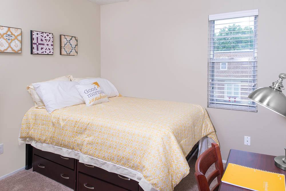 Bedroom with ample storage at University Village