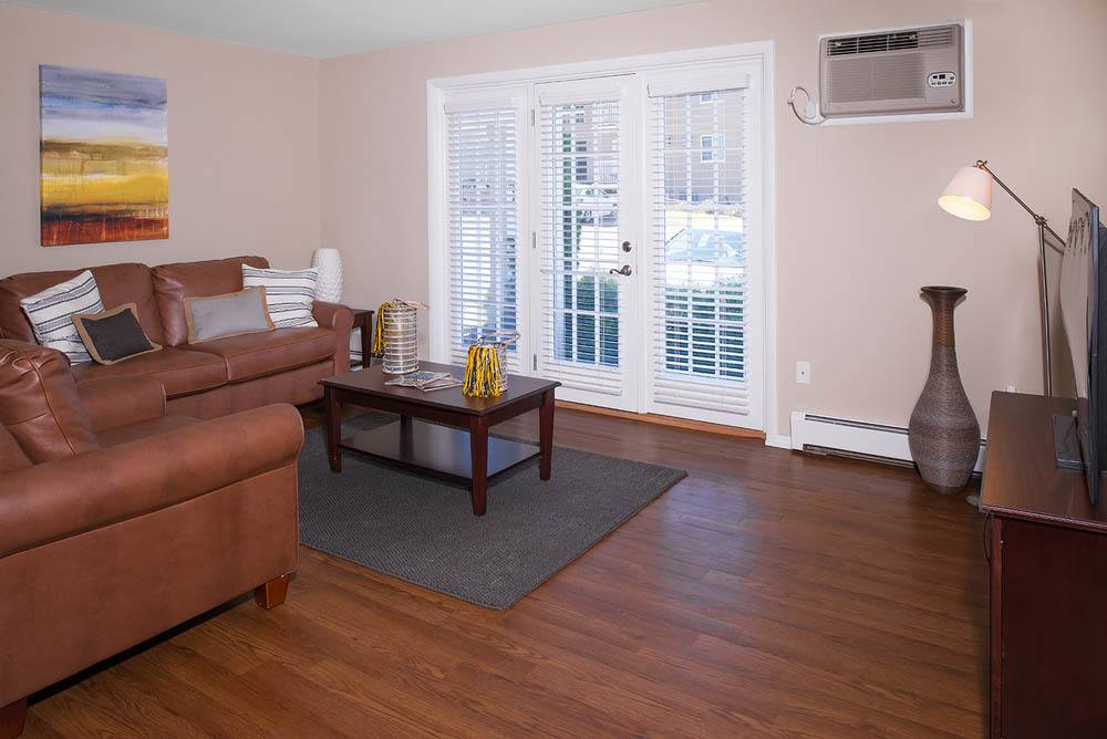 Spacious living room at University Oaks