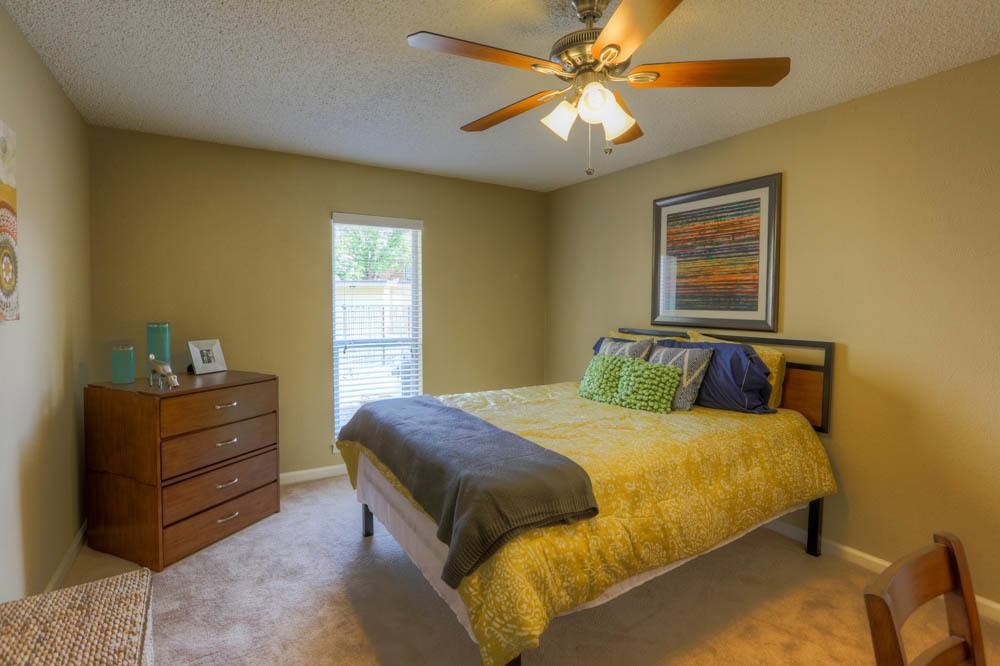 Bright bedroom at Raiders Walk Apartments in Lubbock