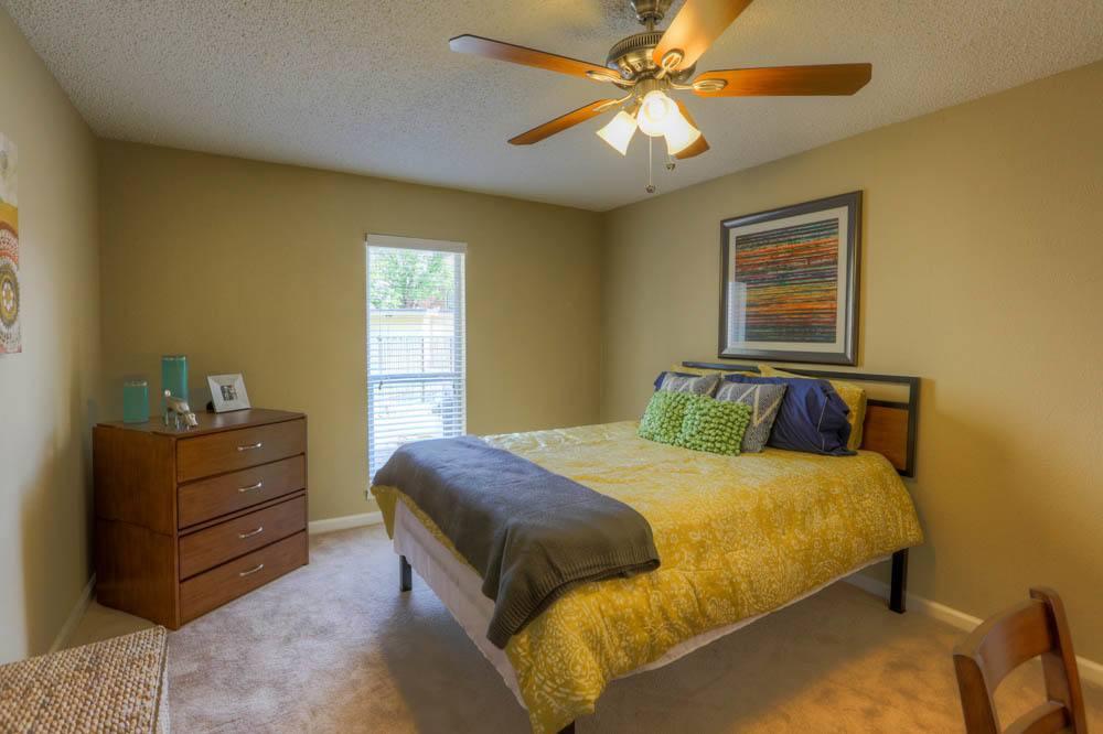 Bright bedroom at Raiders Walk Apartments in Lubbock